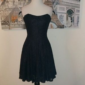 Lace pleated strapless dress.